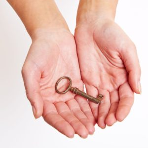 16966158 - the key to success laying on the hand
